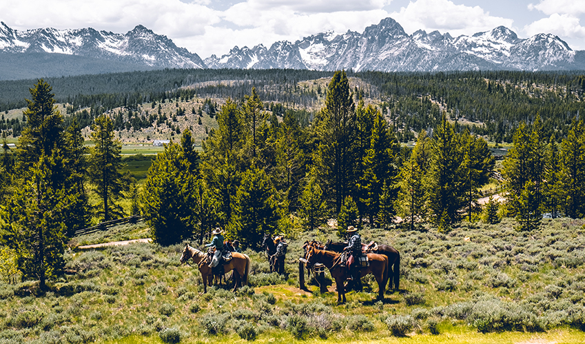 A guided horseback ride through the mountain lakes and at the base of the rockies in the sawtooth mountains